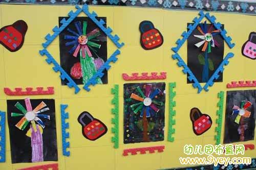 幼儿园走廊墙面设计:漂亮的手工制作品装饰