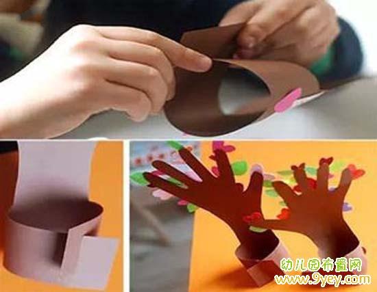 手工材料:硬纸板、彩纸、铅笔、胶水、剪刀  1. 将手按在硬纸板上,用铅笔把手的轮廓画出来  2. 用剪刀将硬纸板上手的轮廓剪下来,记得剪出A,B两道口了,用来连接  3. 拿出彩纸,剪出一些你喜欢的图案,如心形,星星,花朵,叶子等  4. 把剪好的小图案用胶水粘到手形硬纸板上  5.